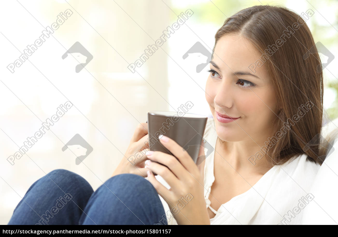 pensive, girl, holding, a, coffee, cup - 15801157