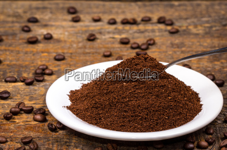ground coffee on white plate with
