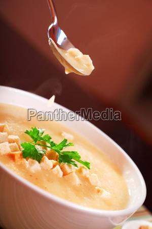 eating potato cream soup eating potato