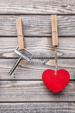 heart and key hanging on a