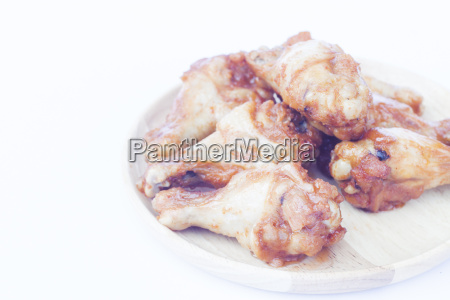 grilled chicken wings isolated on white