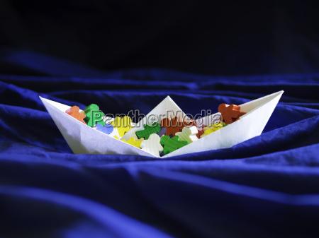 immigration emigration migration concept paperboat with
