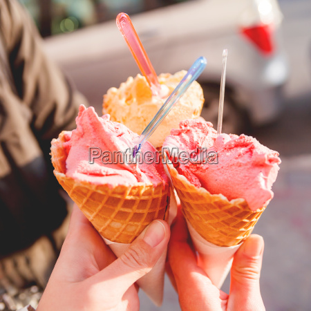 three colorful tasty ice cream cones
