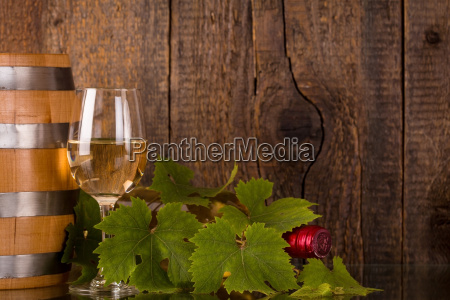 glass of wine with bottle in