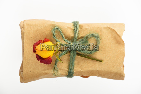 paper wrapped gift with jute bow