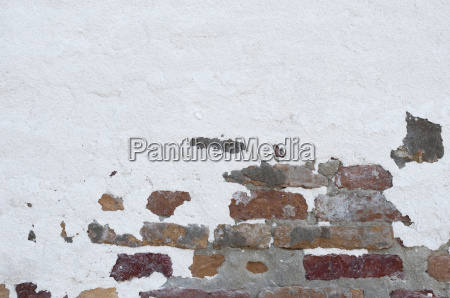 brick wall partially plastered