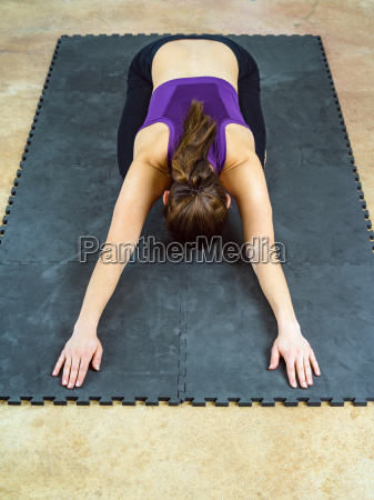 woman doing childs pose yoga position