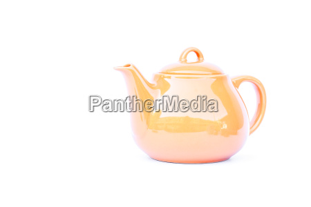 orange ceramic teapot isolated on white