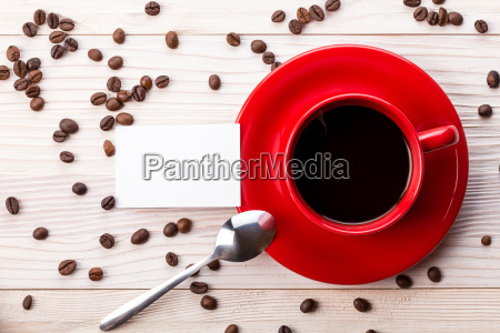 red coffee cup with business card