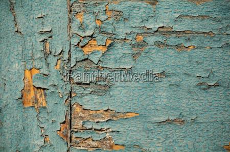 vintage wood wallpaper with peeling turquoise