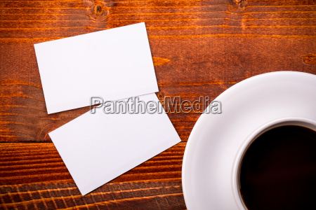 white coffee cup with business card