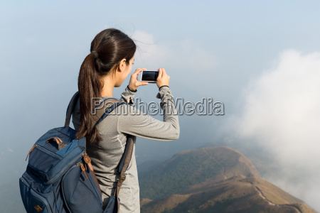 woman taking photo at the top