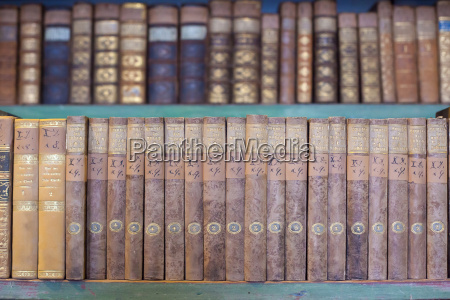 historic old books in library wooden