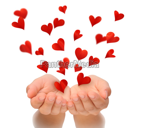 flying hearts from cupped hands of