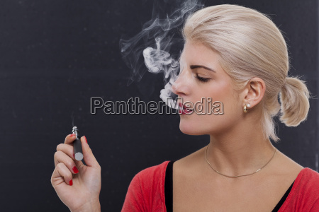 young attractive blonde woman smoking a