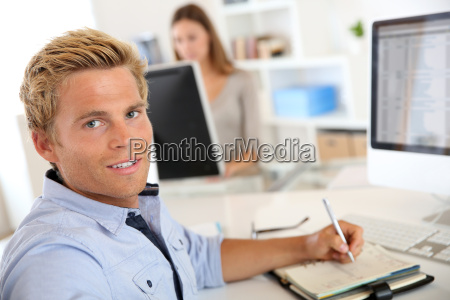 young salesman working in office