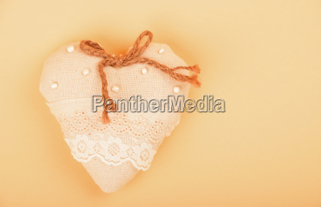 beige toy textile lace heart with