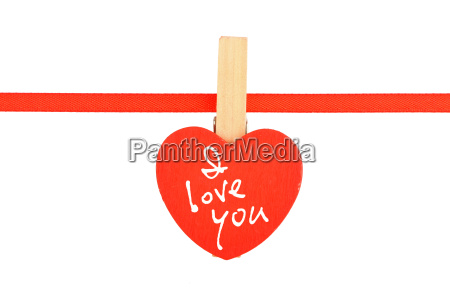 red wooden heart at ribbon isolated