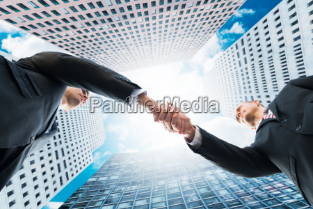 directly below shot of businessmen shaking