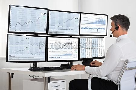 stock market broker looking at graphs
