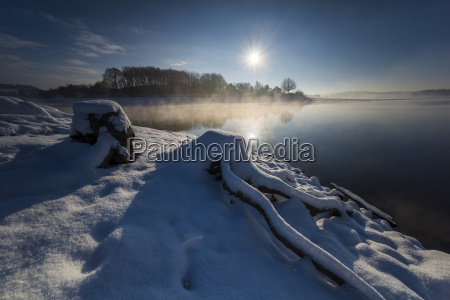 sunrise in the snow with fog