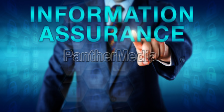 manager pressing information assurance onscreen