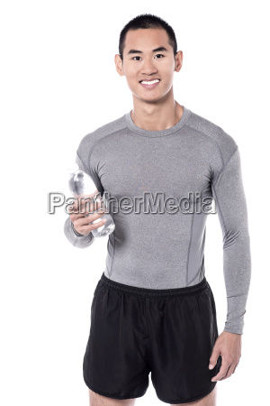 fitness man posing with water bottle