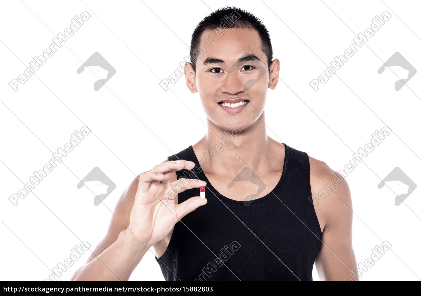 young, man, holding, vitamin, pill - 15882803