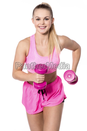 pretty female athlete working oout