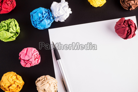 creased color papers with white paper