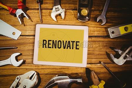 renovate against tablet on green