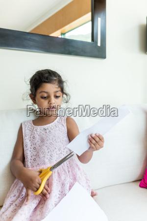 little girl use the scissor for