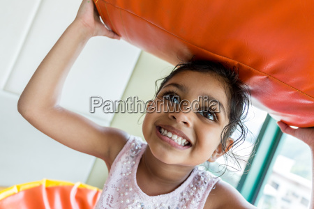indian girl play pillow at home