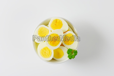 halved hard boiled eggs