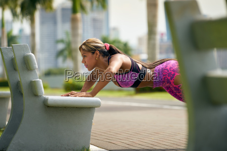 woman training pectorals doing pushups on