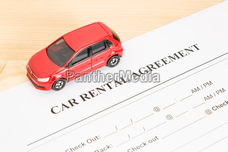 car rental agreement with red car