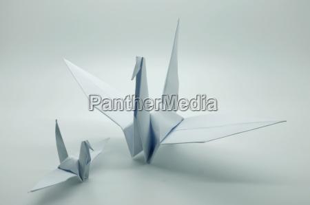 white origami crane bird paper