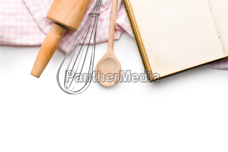 recipe book and kitchen utensils