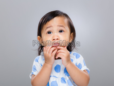 baby girl with funny face expression