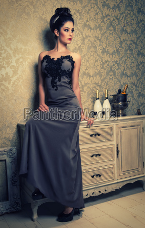 elegant woman in anthracite evening dress