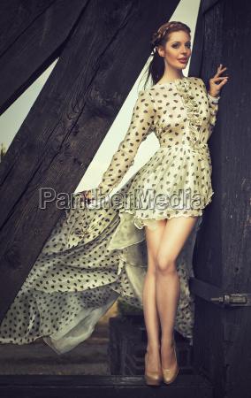 attractive redhead woman in elegant dress
