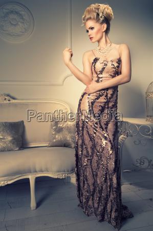 elegant blonde woman in dress