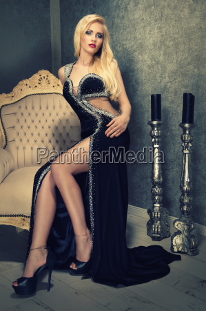 attractive blonde woman in black evening