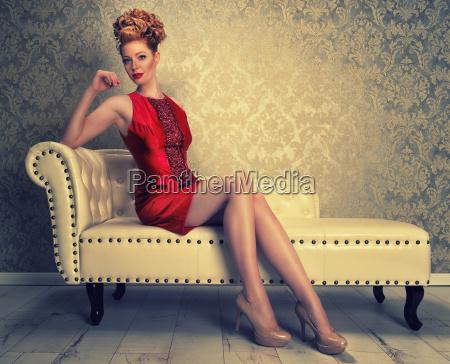 elegant redhead woman on the sofa