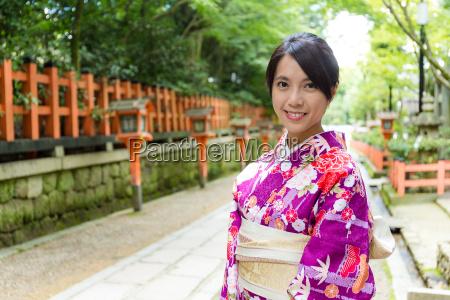 woman wearing the kimono dress
