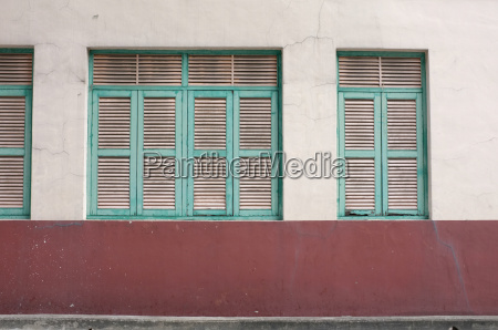 vintage green window on aged wall