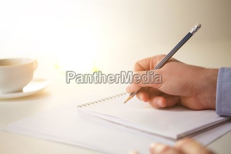 the male hand with a pencil
