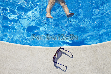 legs in the swimming pool