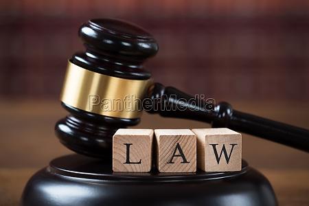 law wooden blocks on mallet in