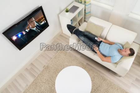 man watching movie on television in
